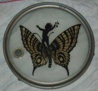 Glazen onderzetter met vlinder en elfje