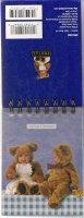 Teddybeer-baby\'s op Anne Geddes notaboekje met