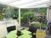 Uw tuinhuis stijlvol afsluiten met glazen